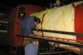 Práce nadruhém pásu skelné vaty