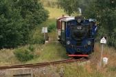 Zvláštní parní vlak slokomotivou U57.001 nazpáteční cestě. Zde na mostě před stanicí Bohušov.